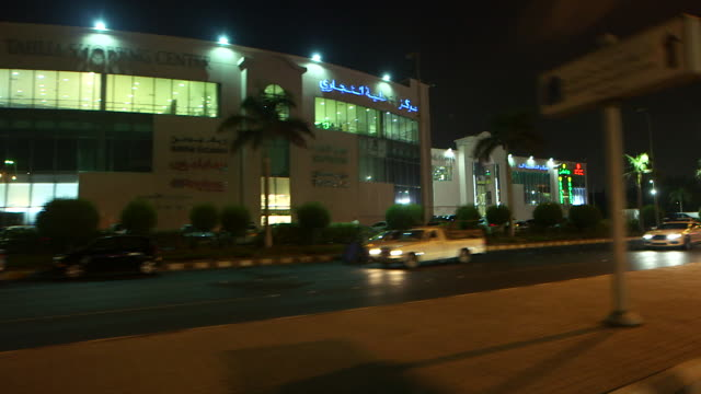 traveling shot, at night, on a street in jeddah. - jiddah stock videos & royalty-free footage