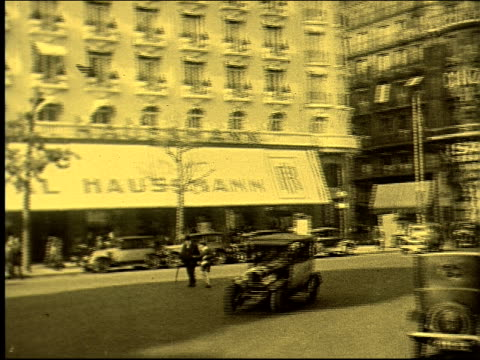 stockvideo's en b-roll-footage met traveling shot pov of car traffic cars automobiles haussmann bus crowded outdoor cafe hats smoking chatting place vendome vendome column rue de... - colonne vendome