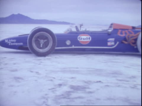 traveling shots from mickey thompson front engine indy race car parked out on salt flat / thompson indy race car speeding along salt flat mickey... - bonneville salt flats stock videos and b-roll footage