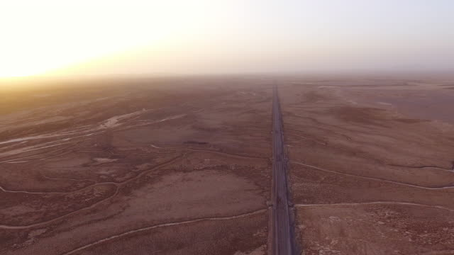 traveling through a desert along a straight endless road in iran. - david ewing stock videos & royalty-free footage