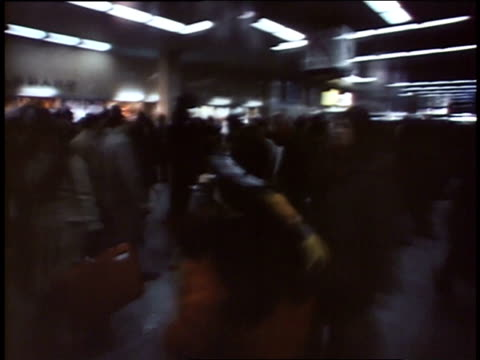 1975 montage traveling through crowd inside building / queens, ny, united states - 1975 stock videos & royalty-free footage