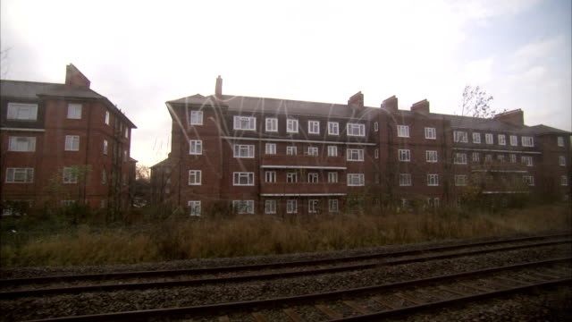 A traveling tube train passes apartments in London. Available in HD.