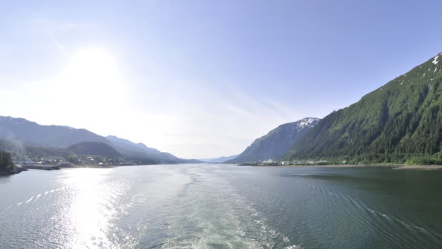 traveling view of the ocean surrounded by mountains at the inside passage in alaska - sea passage stock videos and b-roll footage