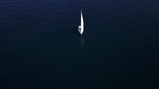 Traveling with a sailboat, sailing along the seas