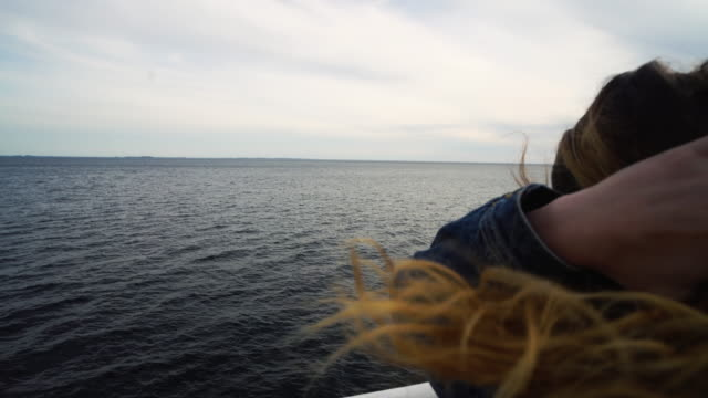 traveling woman freedom: hair in the wind over a ferry boat - ferry stock videos & royalty-free footage