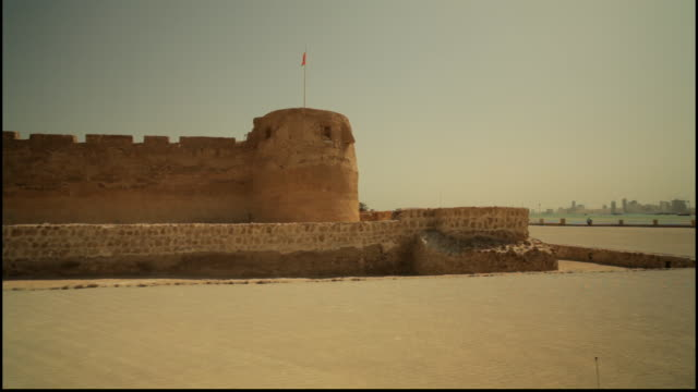 travelingshot around the exterior of the ramparts of the islamic 15th century arad fort - circa 15th century stock videos & royalty-free footage