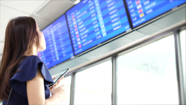 traveller at departure board - air traffic control stock videos & royalty-free footage