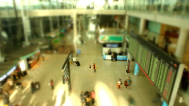 traveller inside international airport,time lapse - airline check in attendant stock videos & royalty-free footage