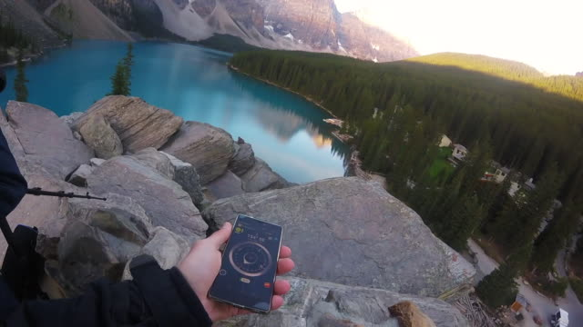 Traveller using digital compass in Canada