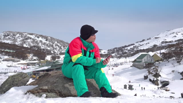 traveller using smart phone on mountain - all horse riding stock videos & royalty-free footage
