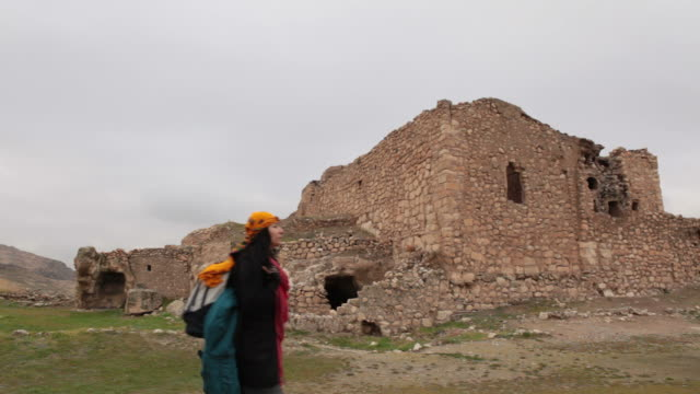 traveller walking into hasankeyf remains - selimaksan stock videos & royalty-free footage