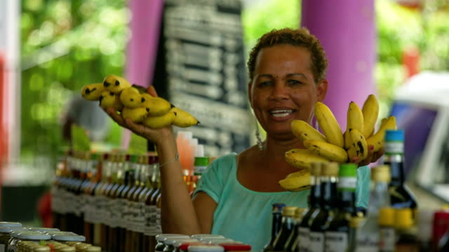 traveller with local vendors on a caribbean market - caribbean stock videos & royalty-free footage