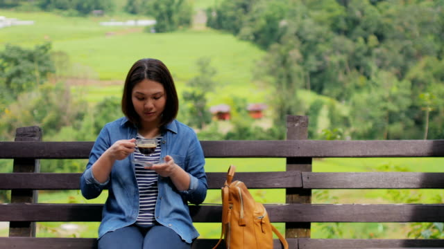 Traveller woman take a coffee at outdoors cafe