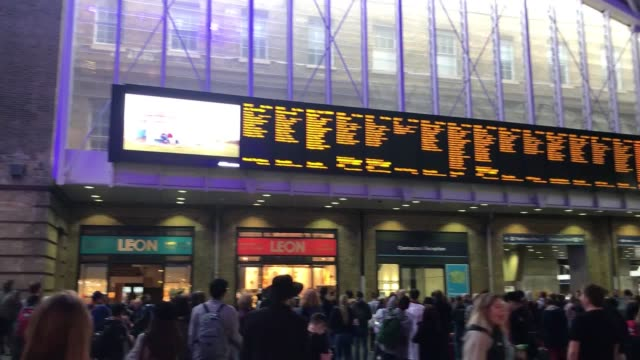 travellers at london's kings cross station, where services continue to be disrupted after nearly one million people across england and wales lost... - cut video transition stock videos & royalty-free footage