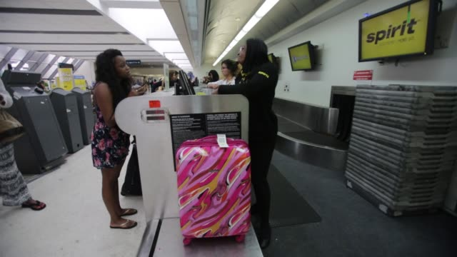 travellers checkin at the spirit airlines co ticket counter inside at the fort lauderdale international airport in fort lauderdale florida us on... - bag stock videos & royalty-free footage