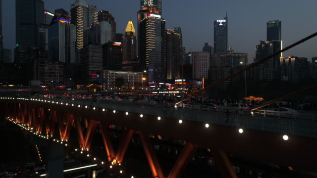travellers gathering on railway bridge deck view city scenic zone and urban cityscape at night - railroad car stock videos & royalty-free footage