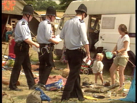 travellers move from romsey site itn romsey lms long line of policemen across field cbv police towards travellers camp track forward ms police across... - police line up stock videos and b-roll footage