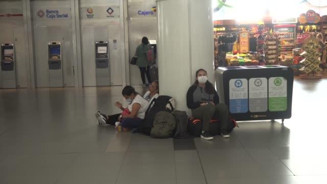 travellers wearing face masks at bogota's el dorado airport in bogota, colombia. - passenger stock videos & royalty-free footage