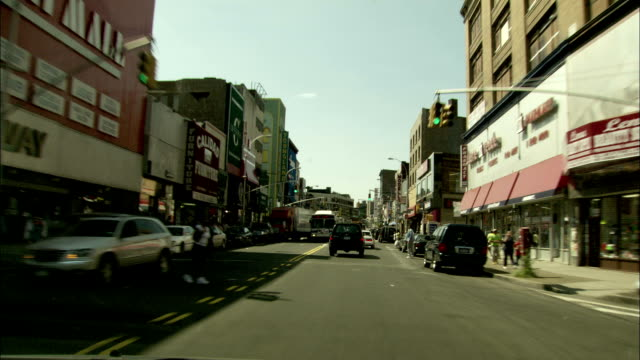 Travelling along a busy street in Greenwich, Connecticut. Available in HD.