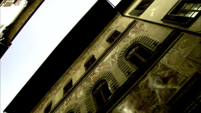 travelling along a narrow florence steet as apartment buildings tower above. available in hd. - tuscany stock videos and b-roll footage