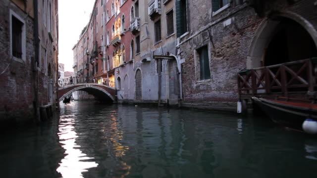 WS BOAT POV Travelling along narrow canal / Venice, Italy