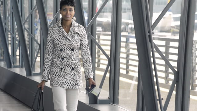 ws ts travelling businesswoman walking through airport / dulles, virginia, usa - dulles international airport stock videos and b-roll footage