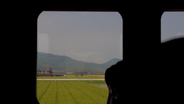 vídeos de stock e filmes b-roll de travelling by train in japan a view from the window - assento de veículo