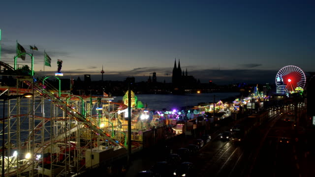 travelling carnival at dusk - volksfest stock-videos und b-roll-filmmaterial