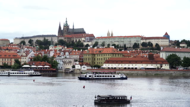 travelling city view of Prague with boat