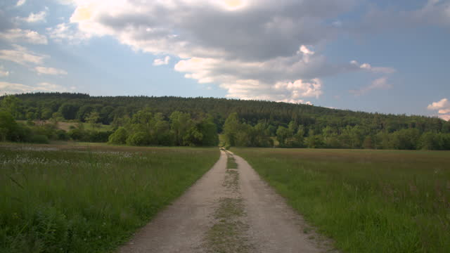 travelling down a dirt road in a field - dirt track stock videos & royalty-free footage