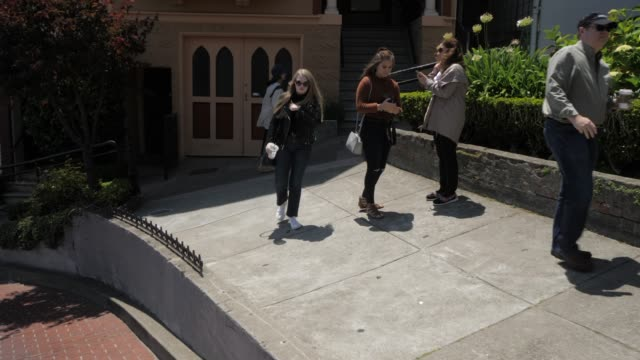travelling down lombard street (crookedest street in the world), san francisco, california, united states of america, north america - lombard street san francisco stock videos & royalty-free footage