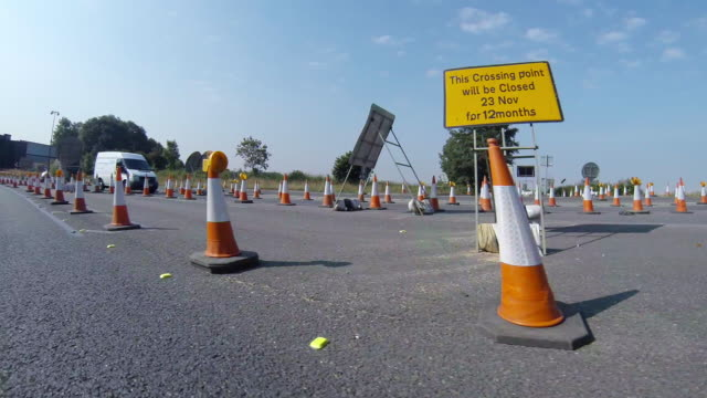 travelling forwards through roadworks road cones - traffic cone stock videos & royalty-free footage