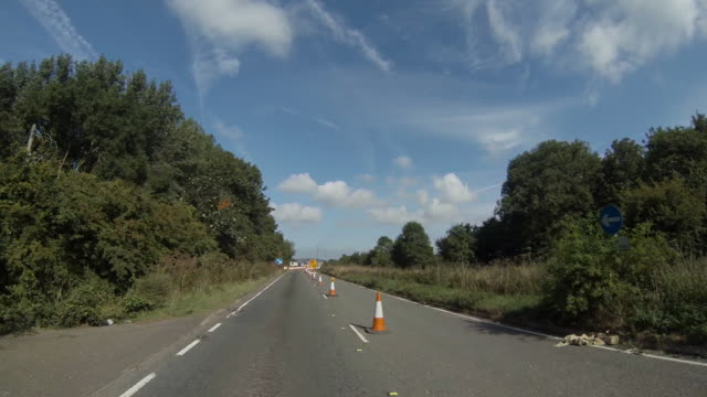 travelling forwards towards roadworks and a contraflow - traffic cone stock videos & royalty-free footage