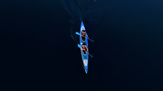 travelling in kayak. view from above - kayak video stock e b–roll