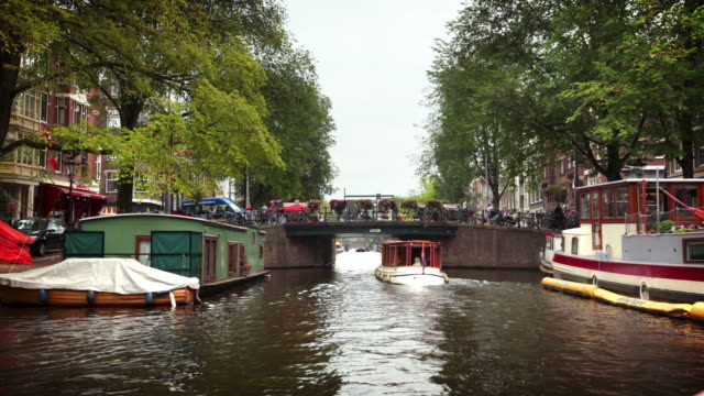 travelling on boat through amsterdam canal - canal stock videos & royalty-free footage