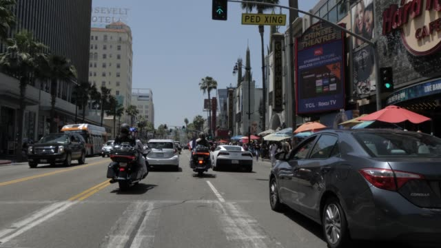 travelling on hollywood boulevard, hollywood and view of tcl chinese theatre, los angeles, california, united states of america, north america - mann theaters stock videos & royalty-free footage