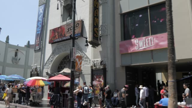 travelling on hollywood boulevard, hollywood and view of tcl chinese theatre, los angeles, california, united states of america, north america - 映画館点の映像素材/bロール