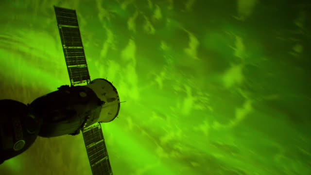 iss travelling over aurora australis - aurora australis stock videos & royalty-free footage