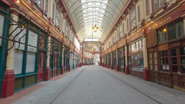 travelling shot of a deserted leadenhall market, during uk lockdown. the government urges the general public to stay at home due to the coronavirus... - famous place stock videos & royalty-free footage