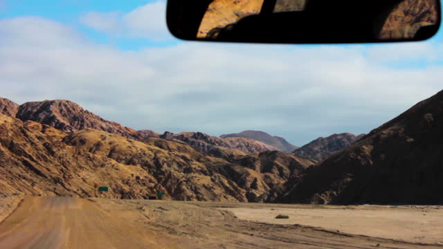 travelling shot of many aspects of sierra vicu–a mackenna and the main road of parque nacional pan de azucar. scenic rock formations everywhere.... - parque nacional stock videos & royalty-free footage