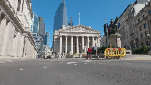 travelling shot of threadneedle street home to the bank of england and the royal exchange, normally one of london's busiest financial districts, as... - city of london stock videos & royalty-free footage