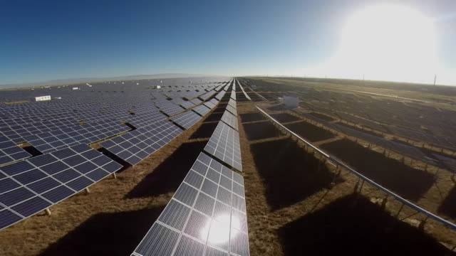 travelling shot over solar panels in china - solar panel stock videos & royalty-free footage