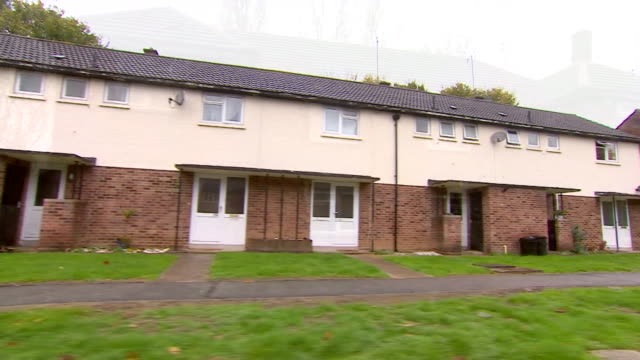 travelling shot past empty boarded up military homes - housing development stock videos & royalty-free footage