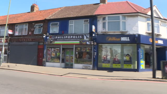 travelling shot through croydon showing william hill betting shops - high street stock videos & royalty-free footage