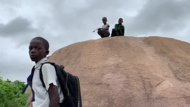 travelling shot through poor rural village outside of harare - hamlet play stock videos and b-roll footage