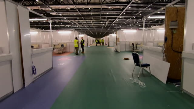 travelling shot through the nhs nightingale hospital still under construction inside the excel centre, a field hospital to cope with demand from the... - nhs stock videos & royalty-free footage