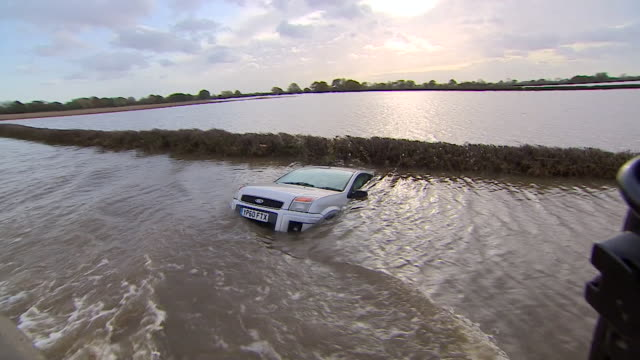 travelling shot through the village of fishlake in doncaster showing extensive flooding and submerged cars - scenics stock videos & royalty-free footage
