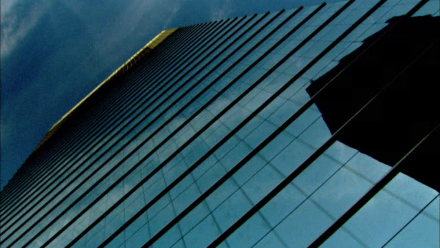 stockvideo's en b-roll-footage met travelling slowly as tall modern buildings tower overhead. available in hd. - low angle view