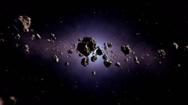 vídeos de stock e filmes b-roll de travelling through asteroid belt - locais geográficos