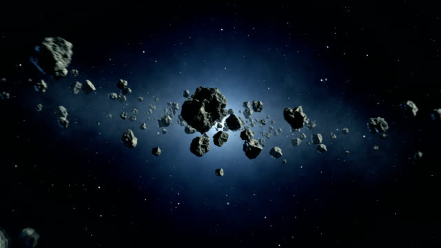 travelling through asteroid belt - stone object stock videos & royalty-free footage